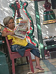 woman in Chinese temple, Yangon, Myanmar