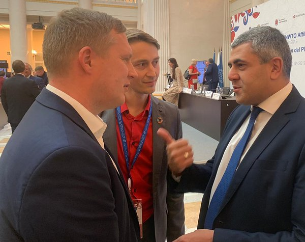 Positium's Erki Saluveer, CEO (left), and Siim Esko, Head of Sales (middle), meeting Zurab Pololikashvili, the Secretary-General of the UN World Tourism Organization (right)