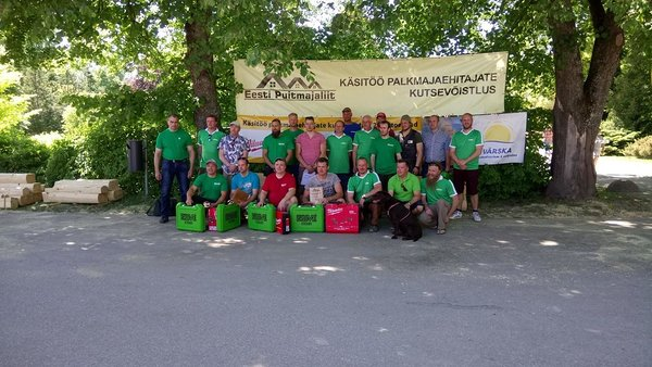 Participants, organizers and supporters of log house builders vocational competition. Photo by: Estonian Woodhouse Association