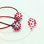 White opal with red dots, red cord and natural white cord