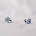 Opaque pale blue glass earrings with dark dots.