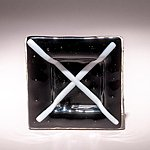 Small fused glass plate, black with white cross