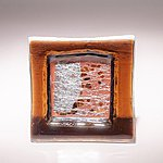 Small fused glass plate, brown with abstract pattern