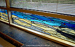 Stained glass window-screen in pool area. Valev Sein