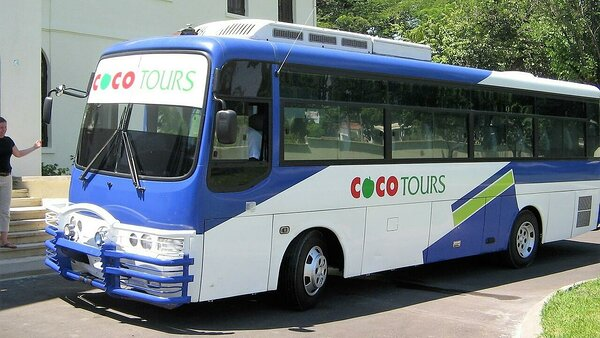 Archive photo of a Cocotours bus of the type we would use for a medium size group on the transfer from Punta Cana to Puerto Plata