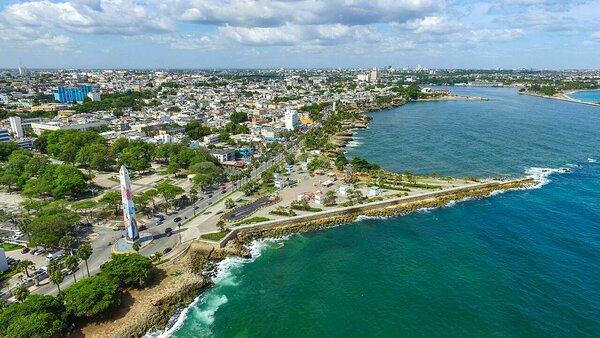The Malecon, Santo Domingo's Caribbean seafront promenade, visited on the Cocotours Santo Domingo tour. In top  right of the picture is where the Ozama river meets the sea, and the location of the Don Diego cruise terminal