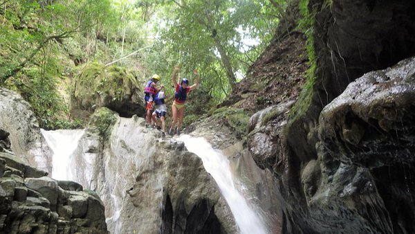 Jumping down alongside one of the 27 waterfalls at Damajagua