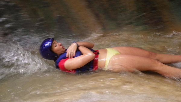 Lottie about to shoot down one of the natural water chutes at the 27 waterfalls at Damajagua