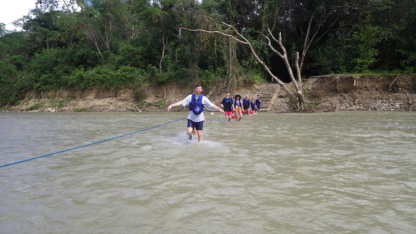 Wading back across the river  Bajabonico at the end of their trip to the 27 waterfalls at Damajagua