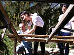 Italian students making a wood shindles roof for a first time