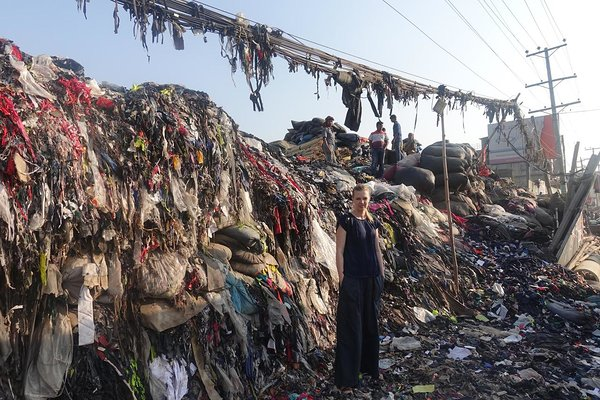 Ann in front of one of the waste dumping sites of an EPZ area in Dhaka