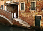 a nun appeared just in the right place, Venice, Italy
