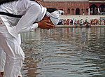 a Sikh boy worshiping at the Golden Temple in Amritsar, India