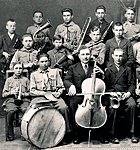 Paul Kondas (with cello) with Suure-Jaani school orchestra