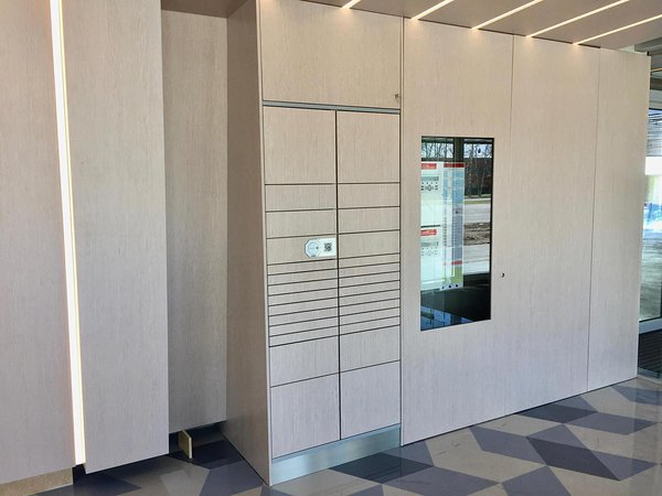 Cleveron 301 smart parcel locker in an apartment complex