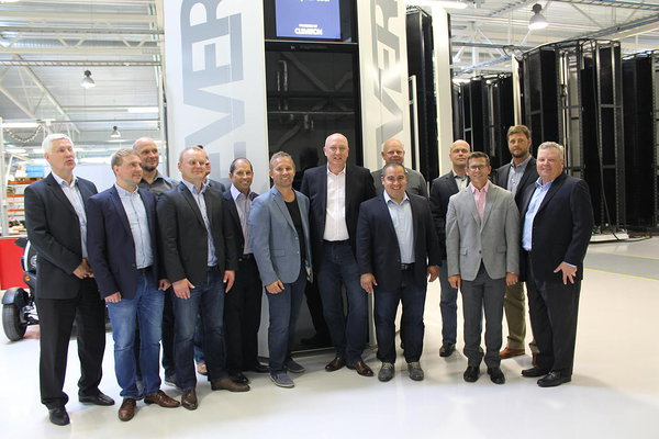 Walmart's delegation posing in front of the Cleveron 401 parcel robot in Cleveron's factory