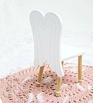 A chair with angel wings