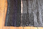 Double-sided handwoven black & grey  rug from recycled textiles