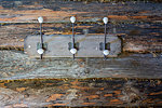 Granary log wall with coat-hooks