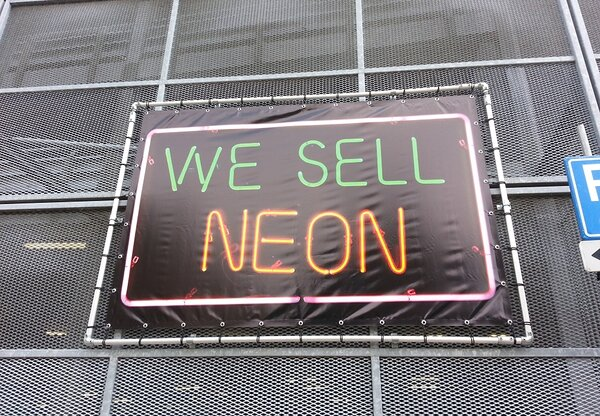 """We Sell Neon,"" UV print on vinyl, steel frame"