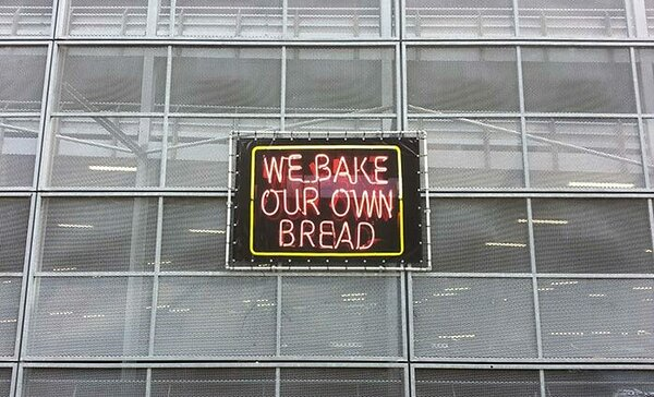 """We Bake Our Own Bread,"" UV print on vinyl, steel frame"